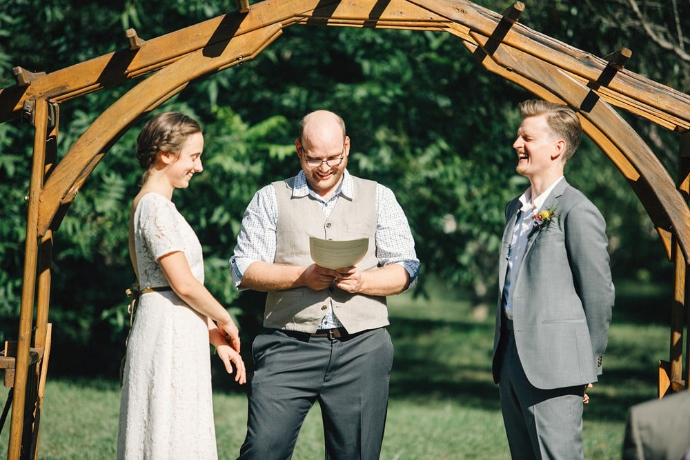 couple laughing during wedding ceremony