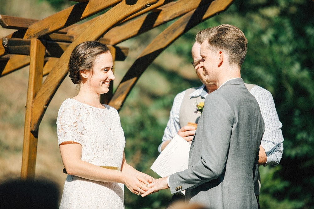 couple exchanging rings wedding ceremony