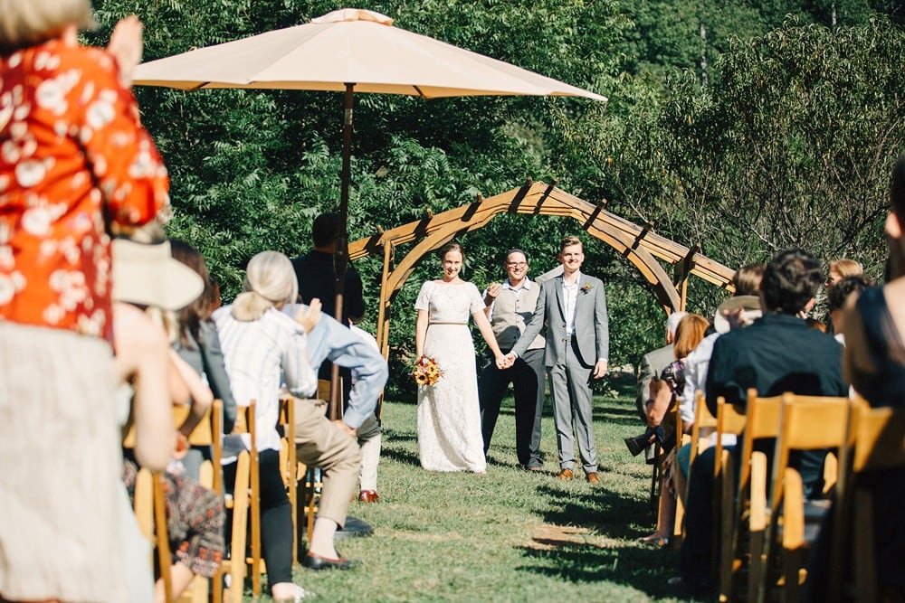 couple holding hands at the altar wedding ceremony brahma ridge