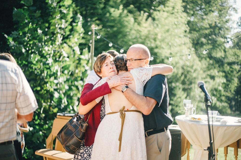 wedding hugging parents