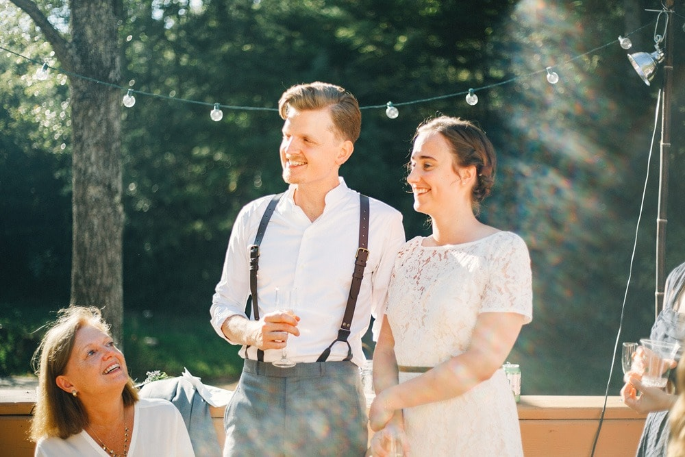 couple smiling during wedding toasts