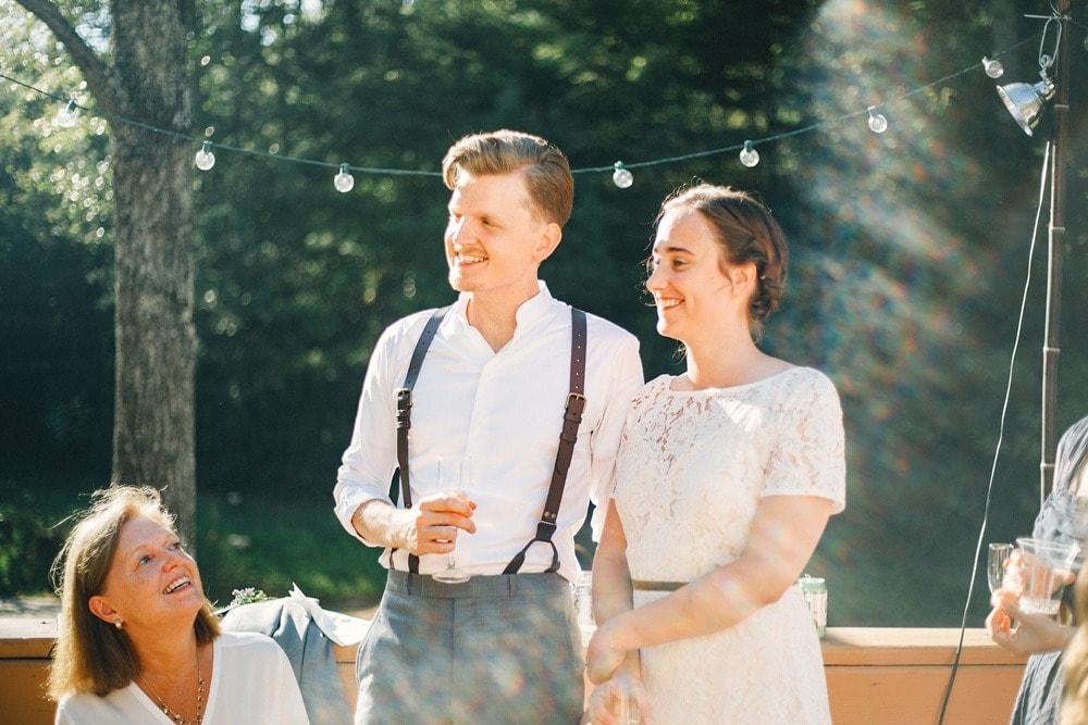 couple smiling during wedding toasts