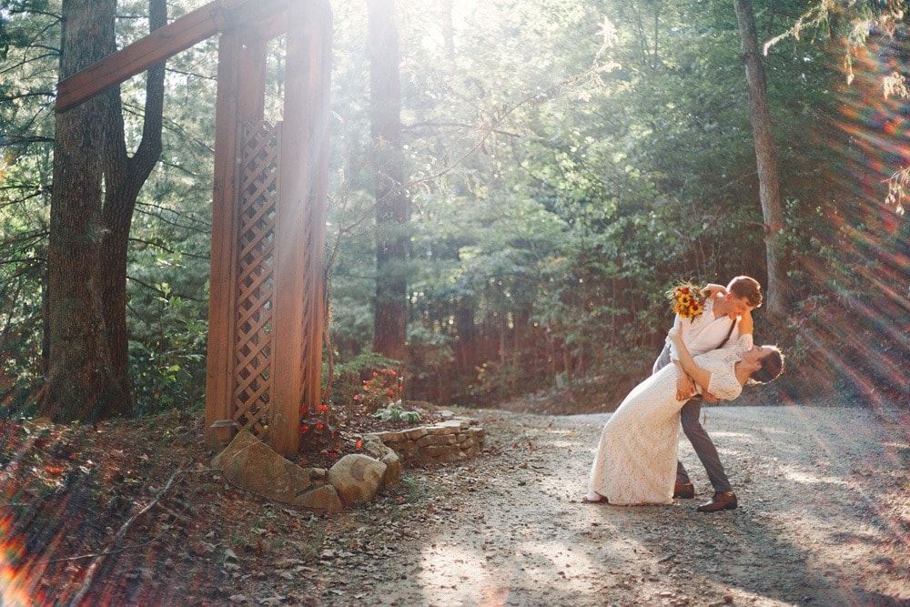 married couple dip under entrance to brahma ridge