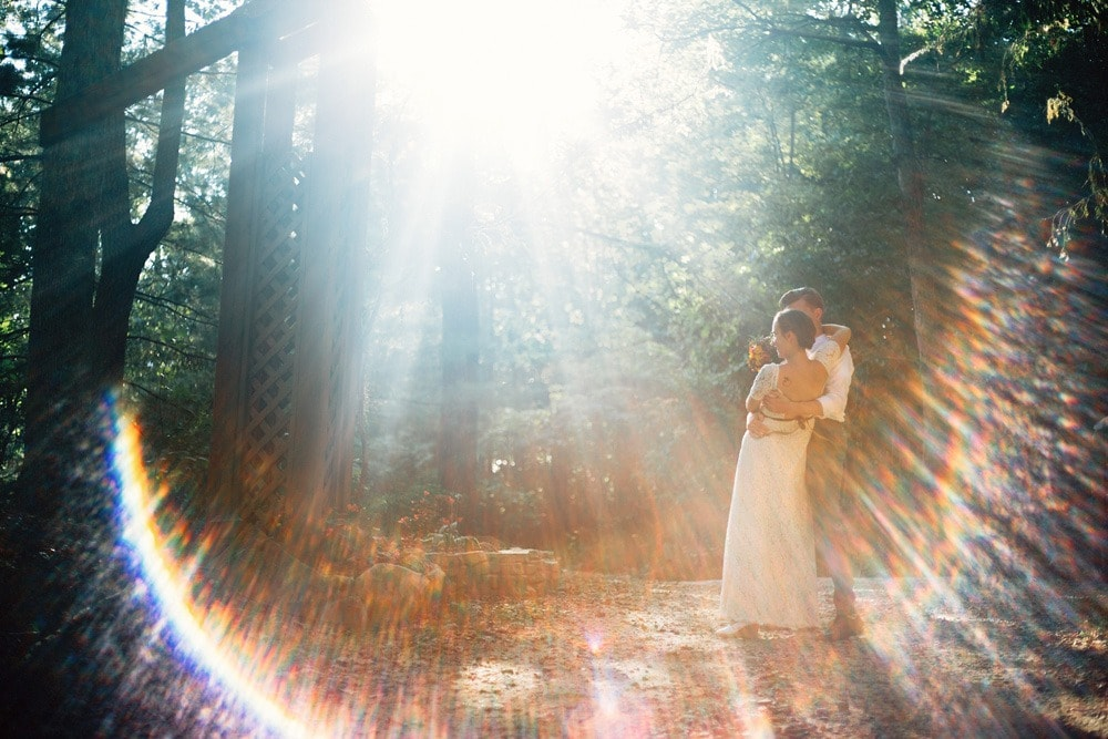 couple in lens flare rainbow