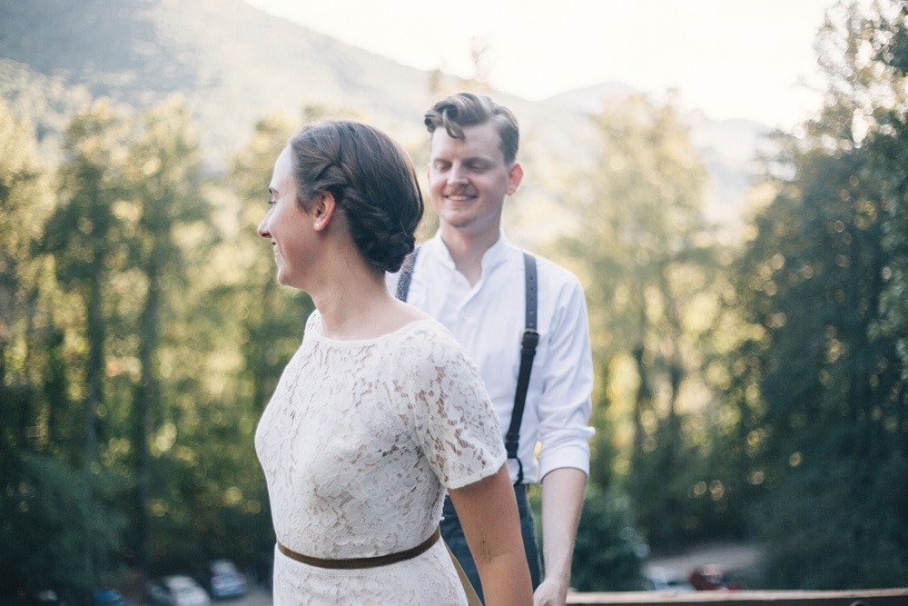 married couple in front of mountain backdrop at brahma ridge
