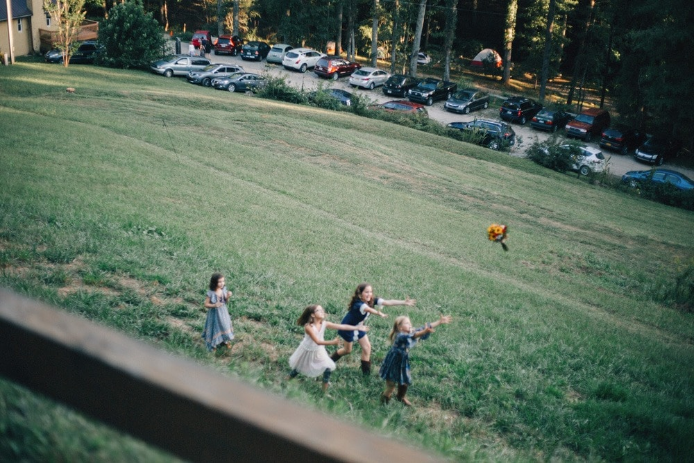 children catching bouquet