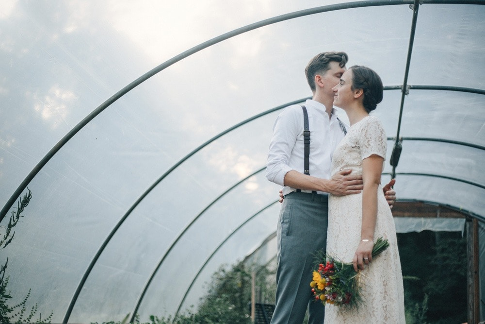 bride and groom in greenhouse at brahma ridge