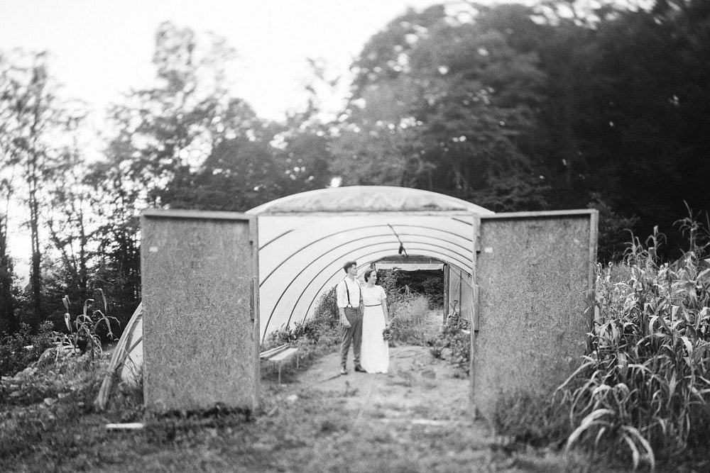 bride and groom in greenhouse at brahma ridge