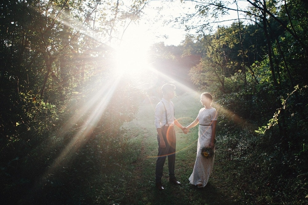 married couple at sunset holding hands