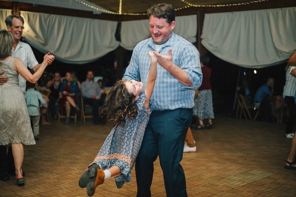 guests square dancing and laughing