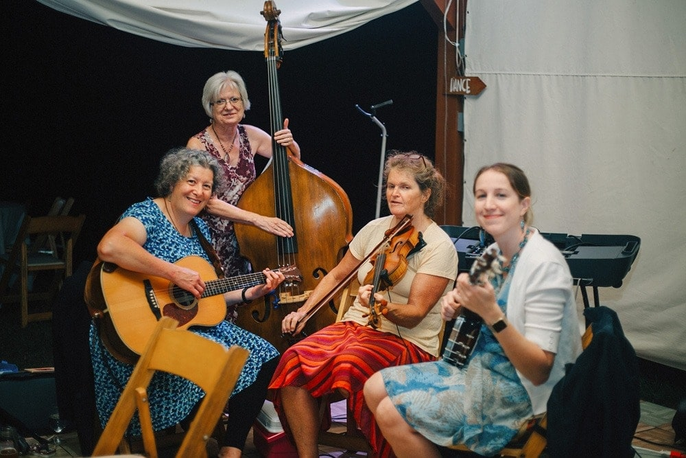 square dance bluegrass band performing and smiling