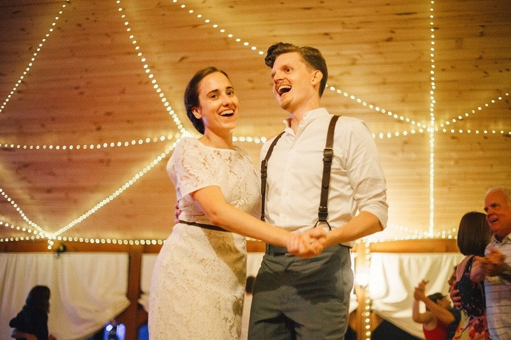 wedding couple laughing while square dancing