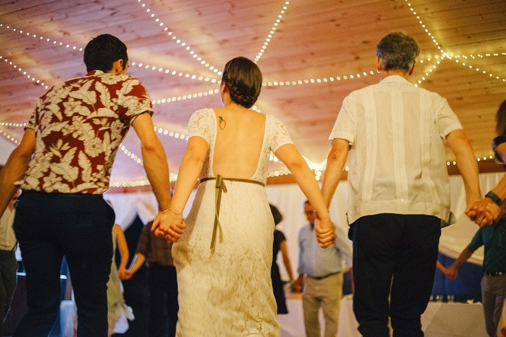 guests square dancing and holding hands