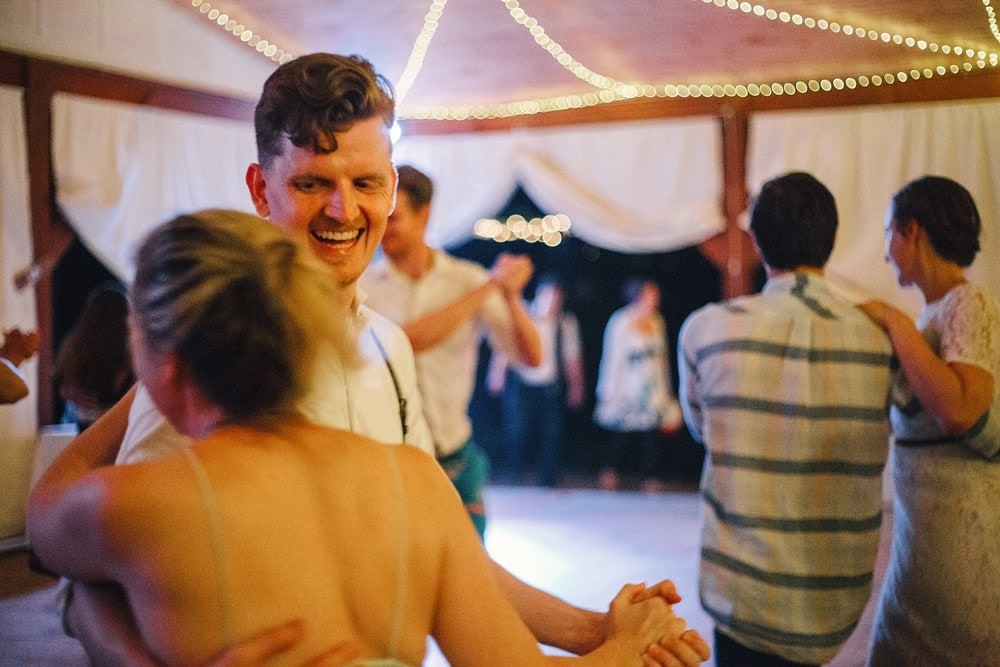 wedding guests square dancing and laughing
