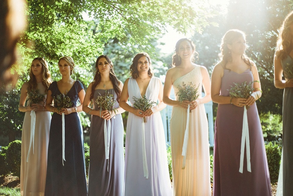bridesmaids during wedding ceremony at lewis ginter botanical gardens
