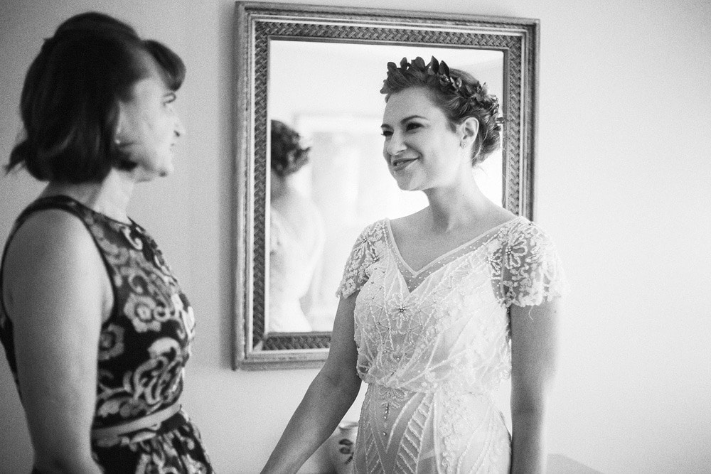 bride and mother getting ready together