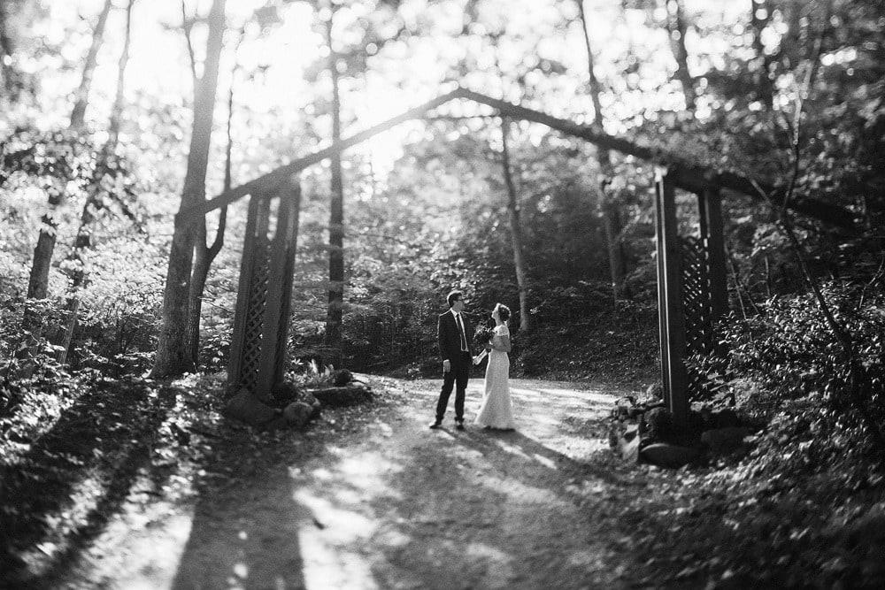 married couple under arch at brahma ridge event center asheville wedding
