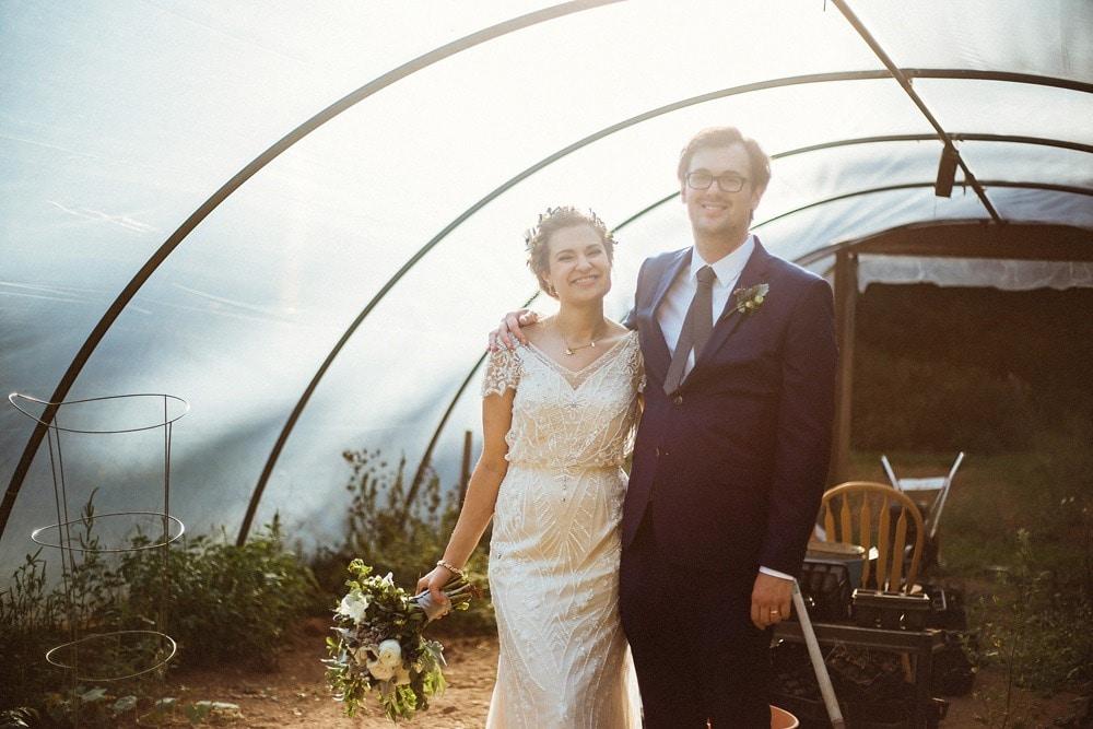 wedding couple in greenhouse at brahma ridge event center