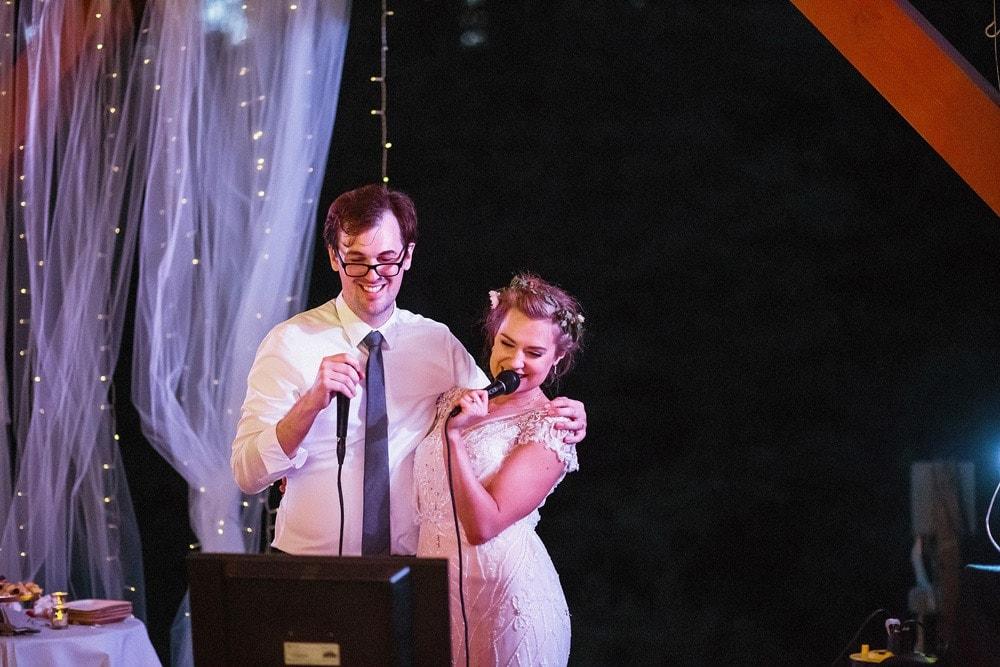 wedding couple singing karaoke