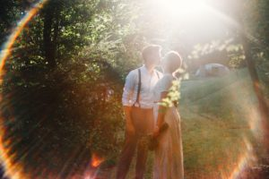 wedding couple in lens flare circle