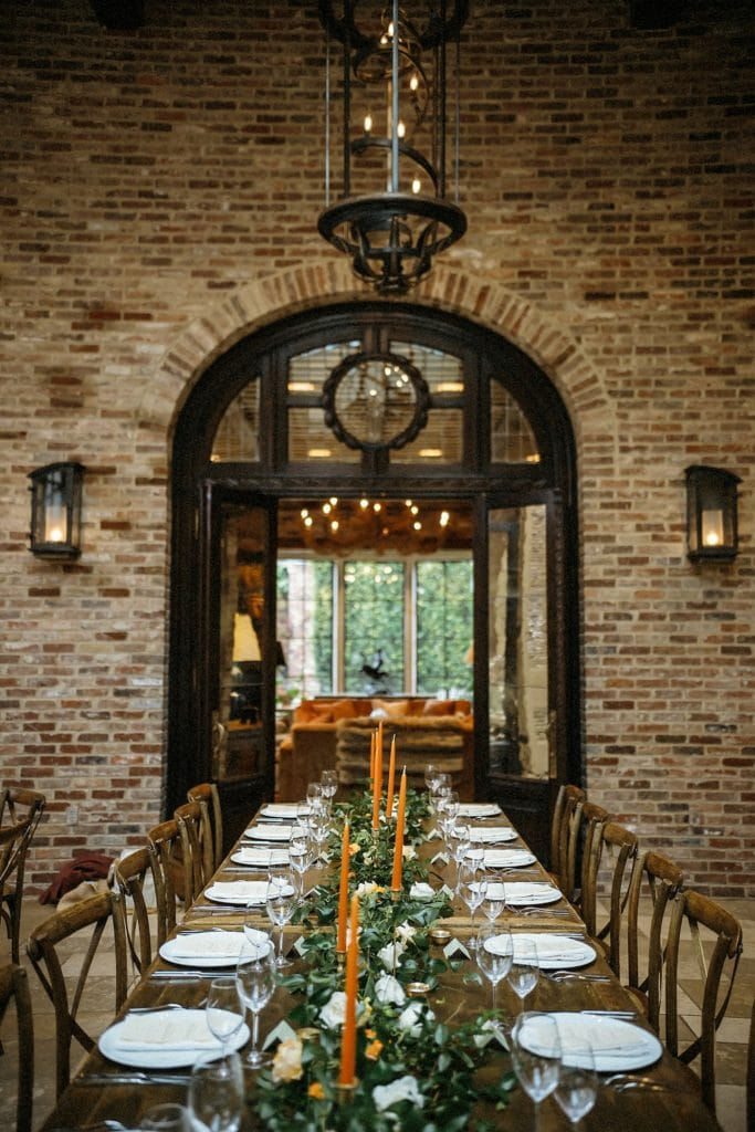 wedding reception farm style table exposed brick walls