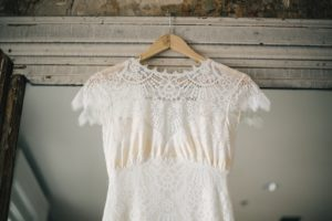 wedding dress on wooden hanger