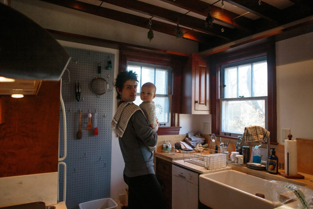 mother and baby in kitchen