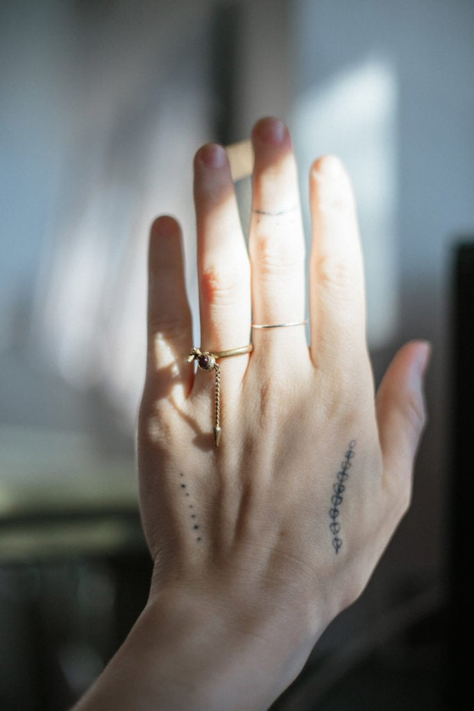tattooed hand with mouse ring