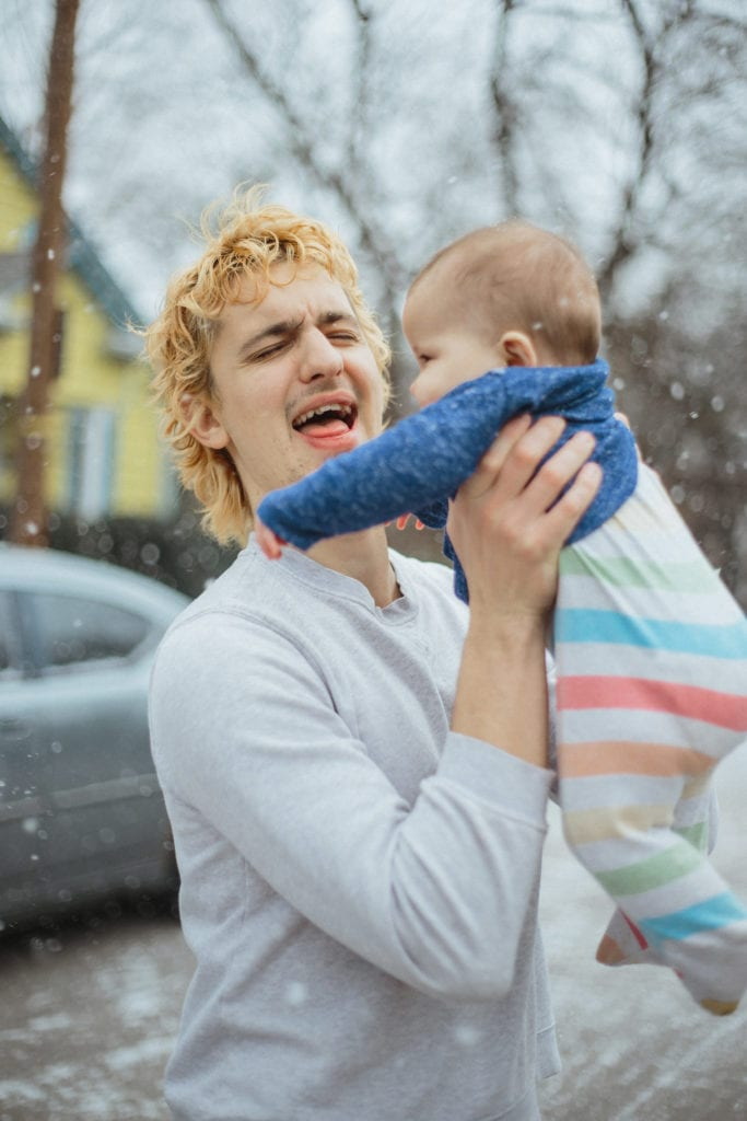 snowing mother and baby in street