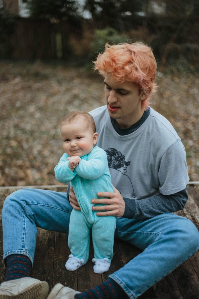 mother with pink hair and baby