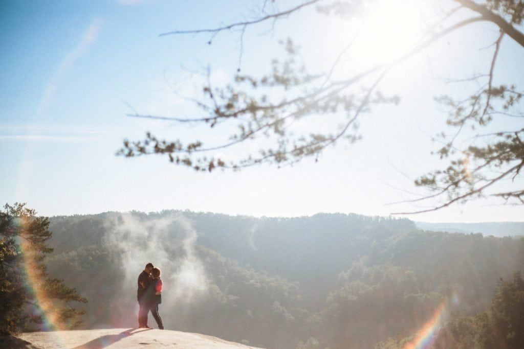 couple at red river gorge sun flare circle