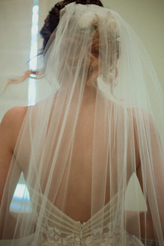 bride back of dress and veil