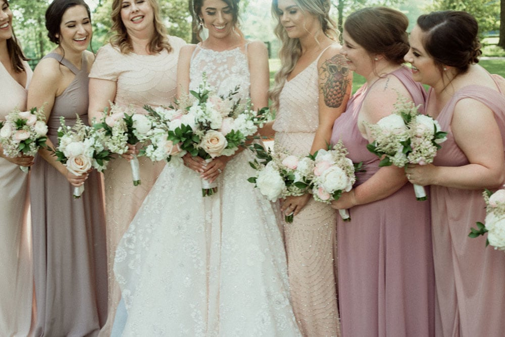 brides and bridesmaids with bouquets by stems llc