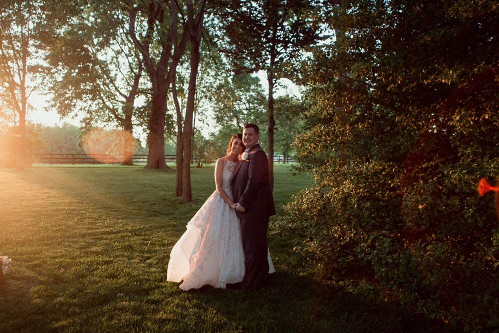 wedding couple at sunset polo barn