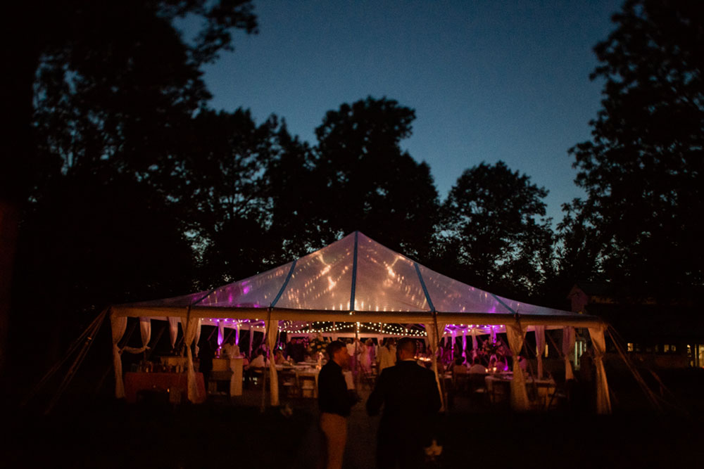 polo barn wedding reception tent at night