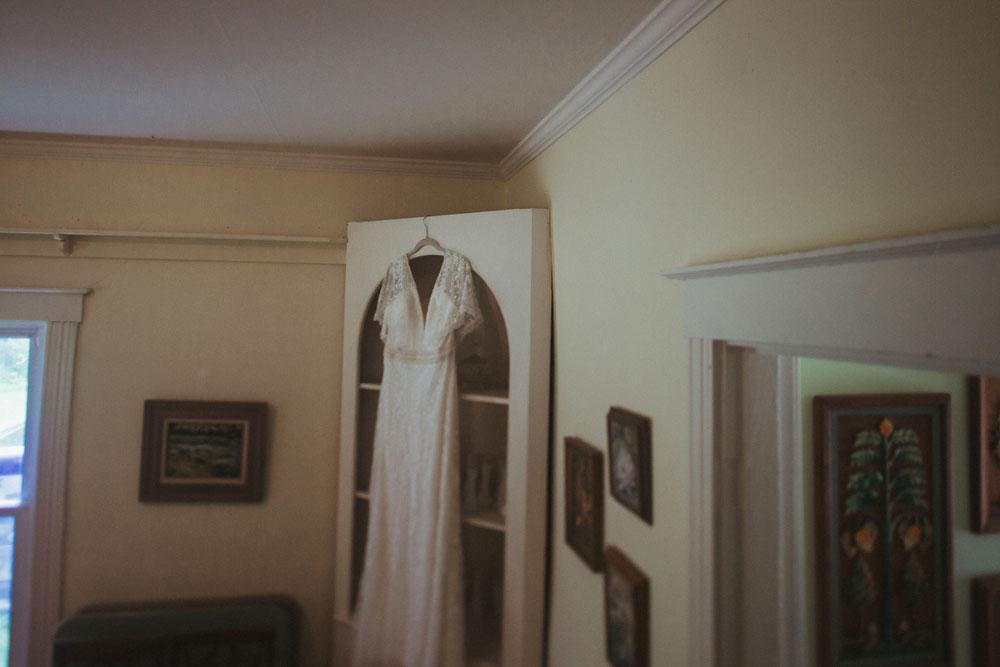 wedding dress hanging on bookcase