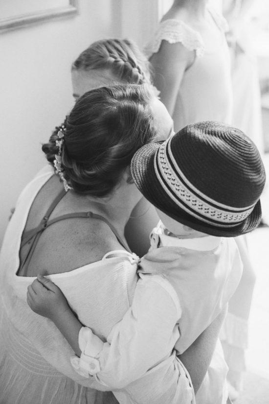 bride hugging ring bearer and flower girl