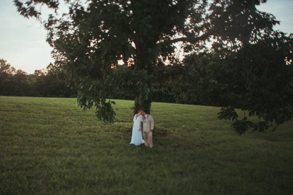 bride and groom under big tree at terrapin hill