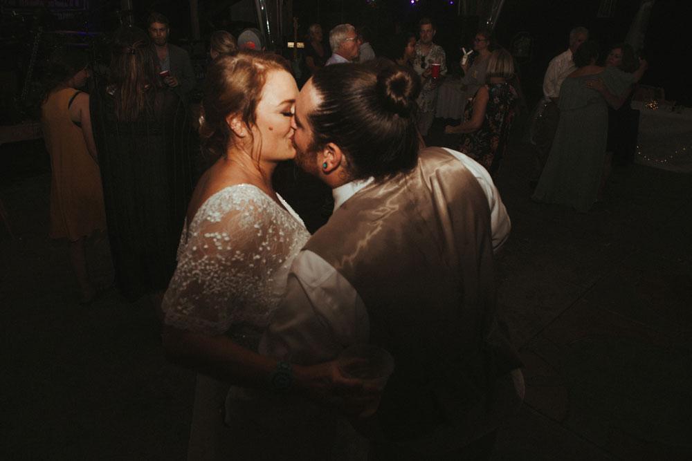 bride and groom kissing at wedding reception, terrapin hill farm