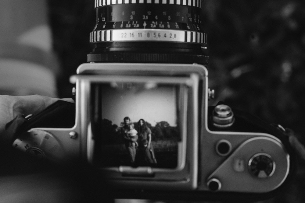 pentacon six medium format camera with family in viewfinder