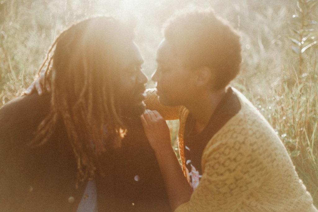 golden hour couple embracing at hisle farm park