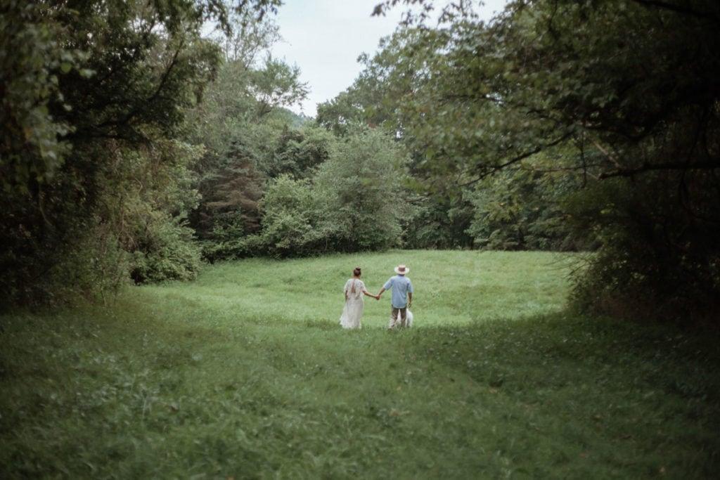 walking in a field in the woods