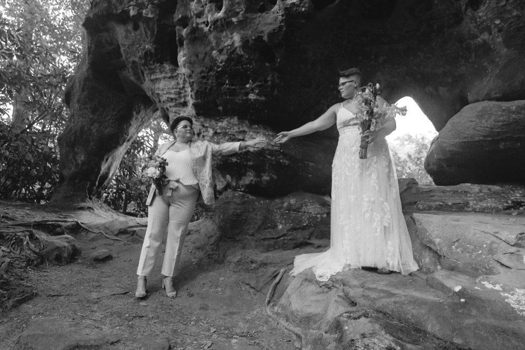 brides portrait hands outstretched